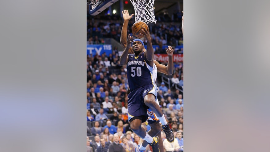Memphis Grizzlies forward Zach Randolph (50) goes up for a shot in front of Oklahoma City Thunder forward Serge Ibaka during the first quarter of an NBA basketball game in Oklahoma City, Thursday, Jan. 31, 2013. (AP Photo/Sue Ogrocki)