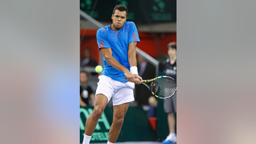 French player Jo Wilfried Tsonga returns the ball to Amir Weintraub of Israel during their match, in the first round of the Davis Cup between Israeli and France, in Rouen, western France, Friday Feb.1, 2013. (AP Photo/Remy de la Mauviniere)