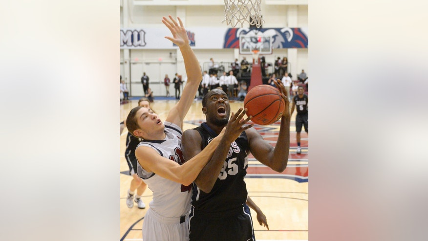 Gonzaga's Sam Dower, right, is fouled by Loyola Marymount forward Marin Mornar during the first half of an NCAA college basketball game, Thursday, Jan. 31, 2013, in Los Angeles. (AP Photo/Mark J. Terrill)