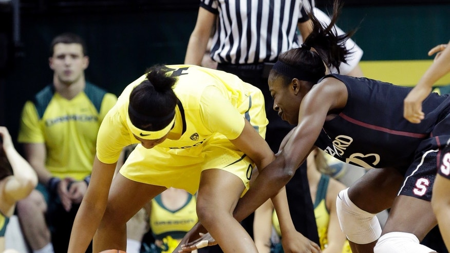 Stanford forward Chiney Ogwumike, right, battles for a loose ball with Oregon forward Jillian Alleyne during the first half of an NCAA college basketball game in Eugene, Ore., Friday, Feb. 1, 2013. (AP Photo/Don Ryan)