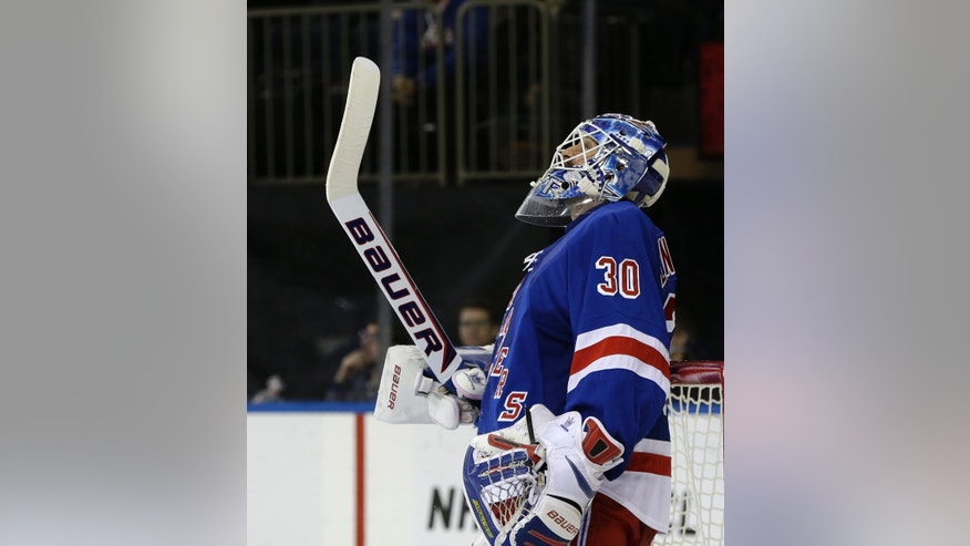 New York Rangers goalie Henrik Lundqvist (30), of Sweden, reacts after Pittsburgh Penguins defenseman Simon Despres (47) scored a goal in the third period of their NHL hockey game in New York, Thursday, Jan. 31, 2013. The Penguins shutout the Rangers 3-0. (AP Photo/Kathy Willens