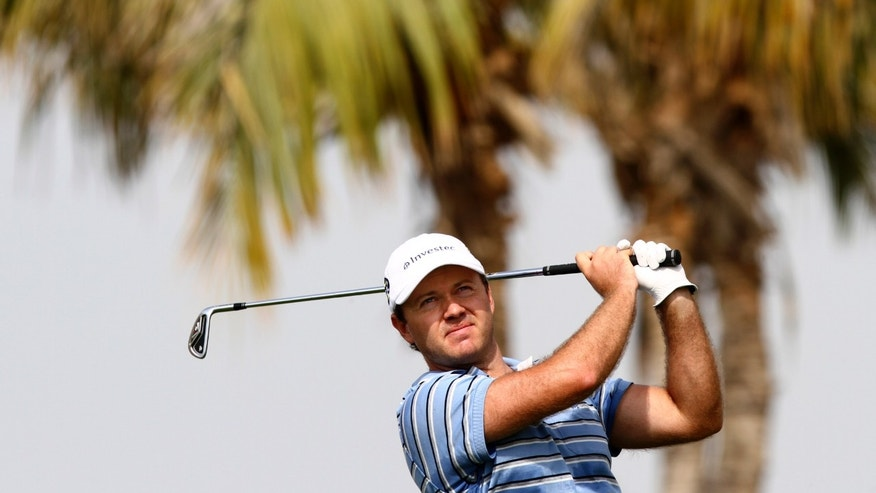 Richard Sterne from South Africa follows his ball on the 4th hole during the first round of the Desert Classic Golf tournament in Dubai, United Arab Emirates, Thursday, Jan. 31, 2013. (AP Photo/Kaveh Kashani)
