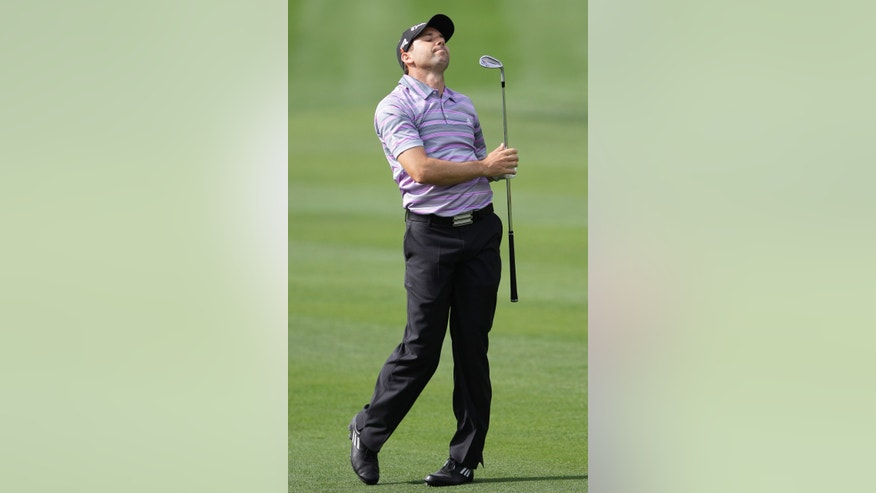 Spain's Sergio Garcia reacts on the 1st hole during the second round of the Dubai Desert Classic Golf tournament in Dubai, United Arab Emirates, Friday, Feb. 1, 2013. (AP Photo/Kamran Jebreili)
