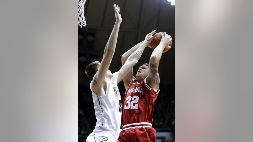 Purdue forward Donnie Hale, left, blocks the shot of Indiana forward Derek Elston during the first half of an NCAA college basketball game in West Lafayette, Ind., Wednesday, Jan. 30, 2013. (AP Photo/Michael Conroy)