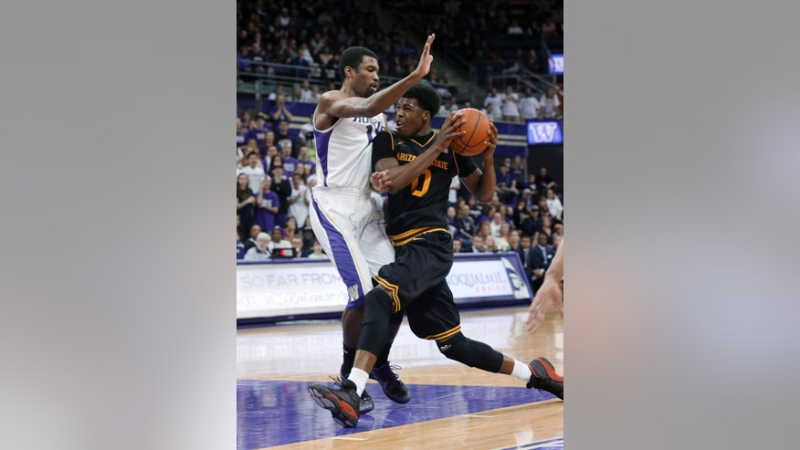 Arizona State's Carrick Felix, right, drives into Washington's Scott Suggs during the first half of an NCAA college basketball game, Saturday, Feb. 2, 2013, in Seattle. (AP Photo/Ted S. Warren)