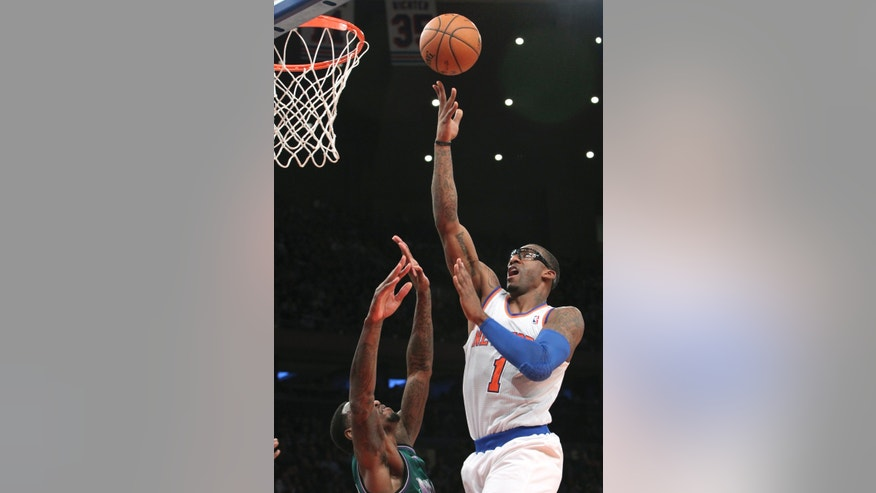 New York Knicks' Amare Stoudemire goes up for a shot against Milwaukee Bucks' Larry Sanders during the first half of NBA basketball game, Friday, Feb. 1, 2013, at Madison Square Garden in New York. (AP Photo/Mary Altaffer)