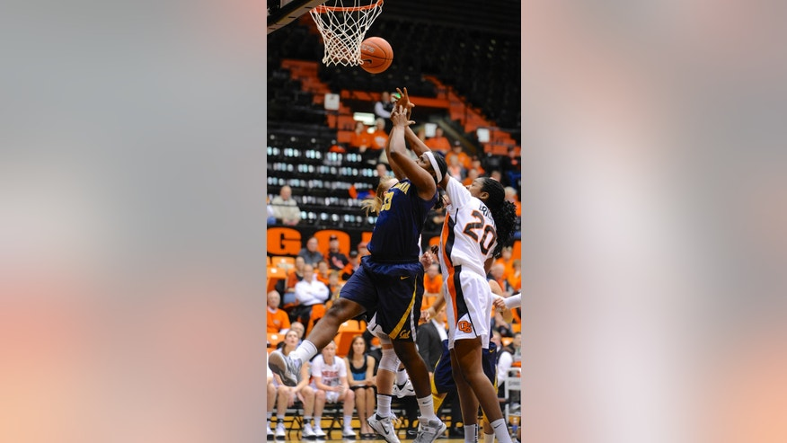 California's Talia Caldwell (33) shoots against Oregon State's Patricia Bright (20) during the first half of an NCAA college basketball game in Corvallis, Ore., Friday, Feb. 1, 2013. (AP Photo/Greg Wahl-Stephens)