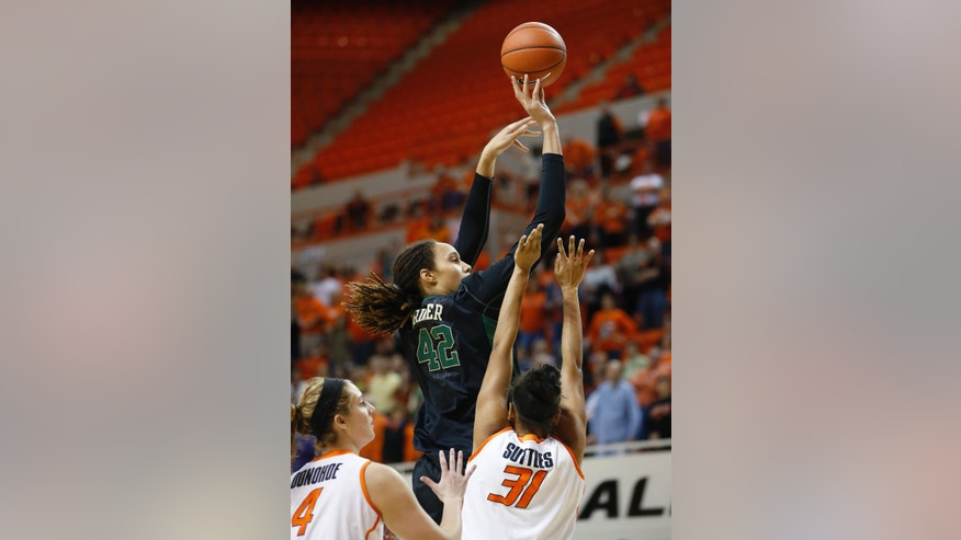 Baylor's Brittney Griner (42) shoots in front of Oklahoma State forward Liz Donohoe (4) and center Kendra Suttles (31) in the first half of an NCAA college basketball game in Stillwater, Okla., Saturday, Feb. 2, 2013. (AP Photo/Sue Ogrocki)