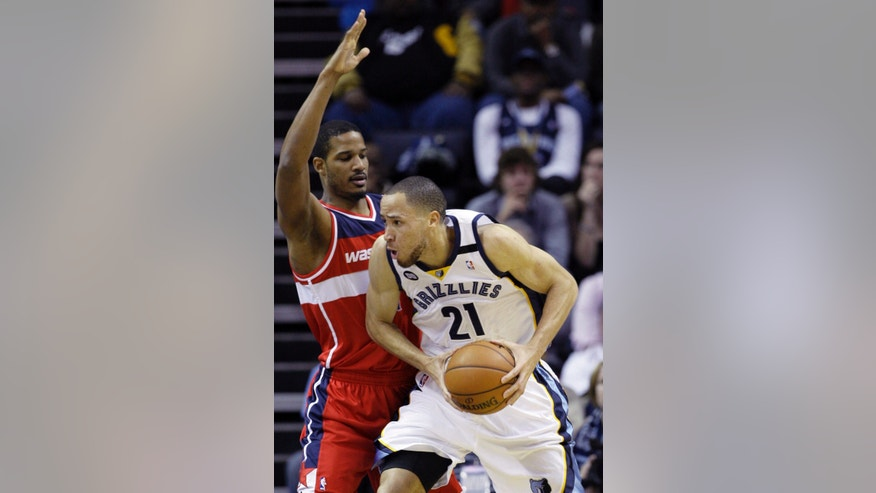 Memphis Grizzlies' Tayshaun Prince (21) is pressured by Washington Wizards' Trevor Ariza during the first half of an NBA basketball game in Memphis, Tenn., Friday, Feb. 1, 2013. Prince, formerly of the Detroit Pistons, was obtained by the Grizzlies in a three-team deal earlier in the week. (AP Photo/Danny Johnston)