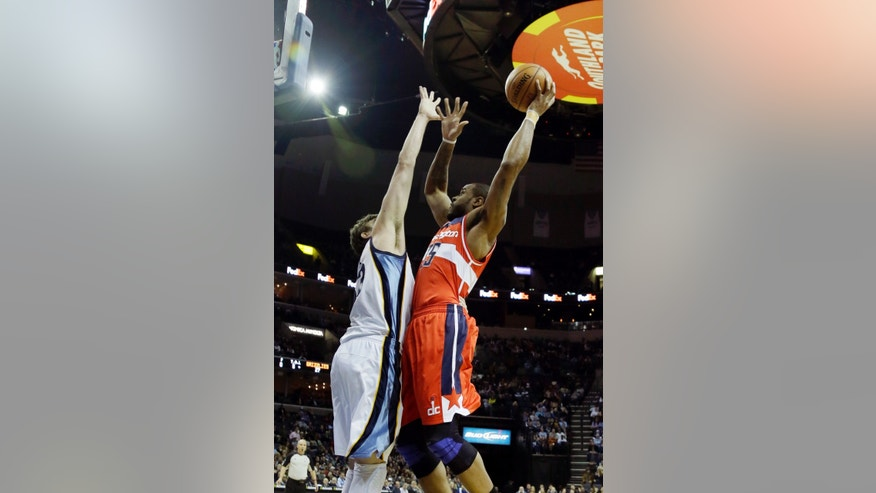 Washington Wizards forward Trevor Booker, right, shoots over Memphis Grizzlies center Marc Gasol, of Spain, during the first half of an NBA basketball game in Memphis, Tenn., Friday, Feb. 1, 2013. (AP Photo/Danny Johnston)