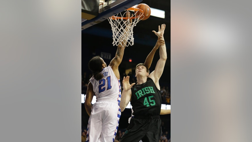 Notre Dame forward Jack Cooley (45) shoots over DePaul guard Jamee Crockett (21) during the first half of an NCAA college basketball game in Rosemont, Ill., on Saturday, Feb. 2, 2013. (AP Photo/Nam Y. Huh)