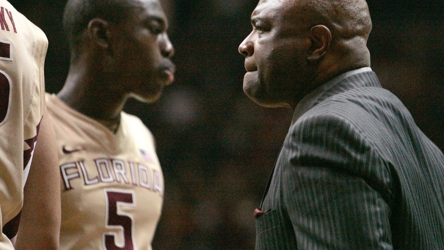 Florida State coach Leonard Hamilton greets his team during a timeout as Duke jumped out to a big lead in the first half of an NCAA college basketball game Saturday, Feb. 2, 2013, in Tallahassee, Fla. Duke won 79-60. (AP Photo/Steve Cannon)