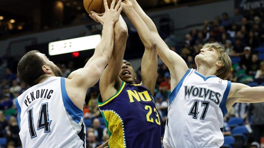 New Orleans Hornets' Anthony Davis, center, is double teamed on a shot attempt by Minnesota Timberwolves' Nikola Pekovic of Montenegro, left, and Minnesota Timberwolves' Andrei Kirilenko of Russia, right, in the first quarter of an NBA basketball game Saturday, Feb. 2, 2013 in Minneapolis. (AP Photo/Jim Mone)