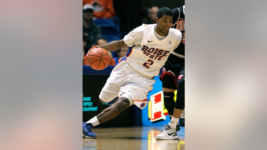 Boise State's Derrick Marks (2) drives past the defense of UNLV during the first half of an NCAA college basketball game, Saturday, Feb. 2, 2013, in Boise, Idaho. (AP Photo/Matt Cilley)