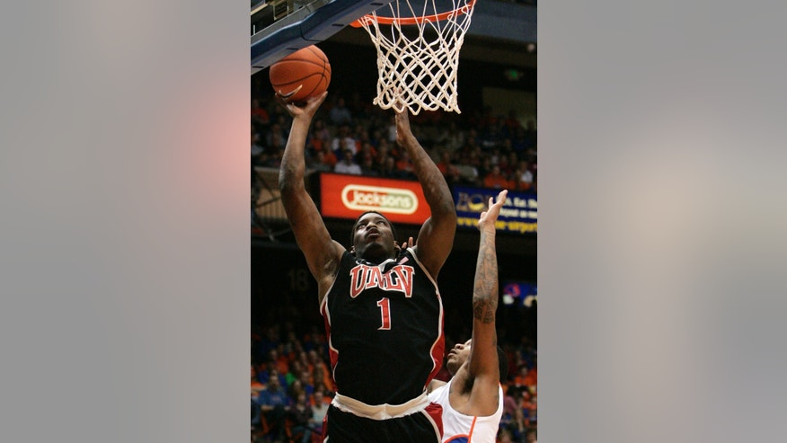 UNLV's Quintrell Thomas (1) shoots against Boise State during the first half of an NCAA college basketball game, Saturday, Feb. 2, 2013, in Boise, Idaho. (AP Photo/Matt Cilley)