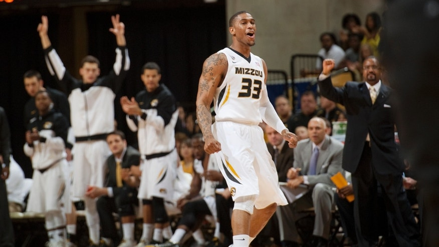 Missouri's Earnest Ross (33) celebrates in front of the Missouri bench after making a three-point shot during the first half of an NCAA college basketball game against Auburn Saturday, Feb. 2, 2013, in Columbia, Mo. Ross is a transfer from Auburn. (AP Photo/L.G. Patterson)