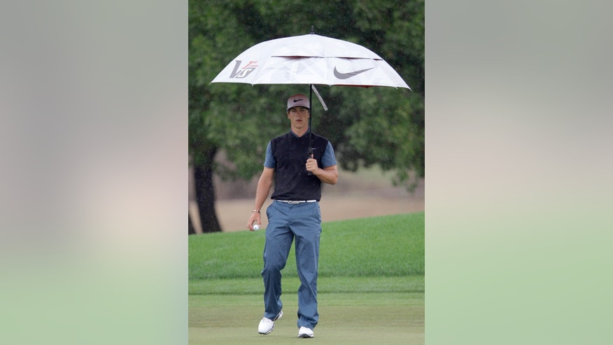Thorbjorn Olesen from Denmark studies his play under the rain on the 2nd hole during third round of the Dubai Desert Classic Golf tournament in Dubai, United Arab Emirates, Saturday, Feb. 2, 2013. (AP Photo/Kamran Jebreili)