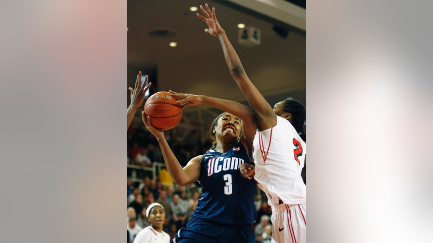 Connecticut forward Morgan Tuck (3) shoots a basket against St. John's forward Amber Thompson (2) during the first half of theiranNCAA college basketball game, Saturday, Feb. 2, 2013, at St. John's University in New York. (AP Photo/John Minchillo)