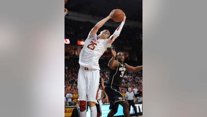 Maryland center Alex Len (25) grabs the ball against Wake Forest forward Travis McKie (30) during the second half of an NCAA college basketball game, Saturday, Feb. 2, 2013, in College Park, Md. Maryland won 86-60. (AP Photo/Nick Wass)