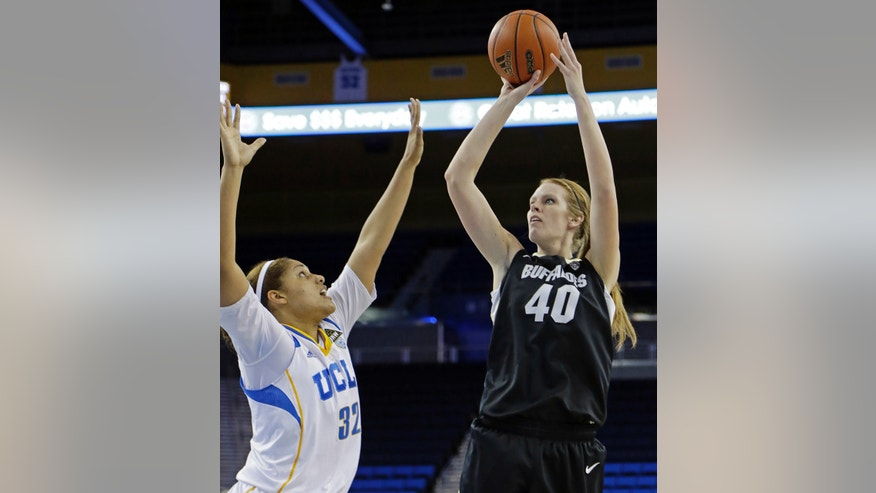 Colorado center Rachel Hargis (40) shoots over UCLA forward Alyssa Brewer (32) in the first half of an NCAA women's college basketball game in Los Angeles Friday, Feb. 1, 2013. (AP Photo/Reed Saxon)