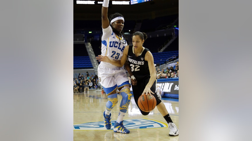 Colorado forward Arielle Roberson (32) drives past UCLA guard/forward Markel Walker (23) in the first half of an NCAA women's college basketball game in Los Angeles Friday, Feb. 1, 2013. (AP Photo/Reed Saxon)