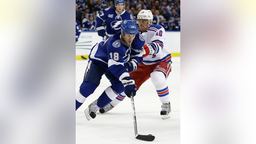 New York Rangers right wing Marian Gaborik (10), of Slovakia, gets a stick under the chin of Tampa Bay Lightning right winger Adam Hall (18) during the first period of an NHL hockey game on Saturday, Feb. 2, 2013, in Tampa, Fla. (AP Photo/Chris O'Meara)