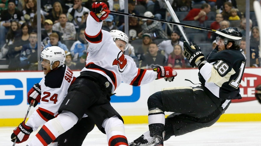 Pittsburgh Penguins' James Neal (18) and New Jersey Devils' Anton Volchenkov (28) collide during the second period of an NHL hockey game on Saturday, Feb. 2, 2013 in Pittsburgh. (AP Photo/Keith Srakocic)