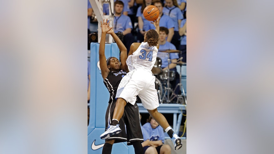 Duke's Elizabeth Williams draws a foul as North Carolina's Xylina McDaniel (34) drives to the basket during the first half of an NCAA college basketball game in Chapel Hill, N.C., Sunday, Feb. 3, 2013. (AP Photo/Gerry Broome)