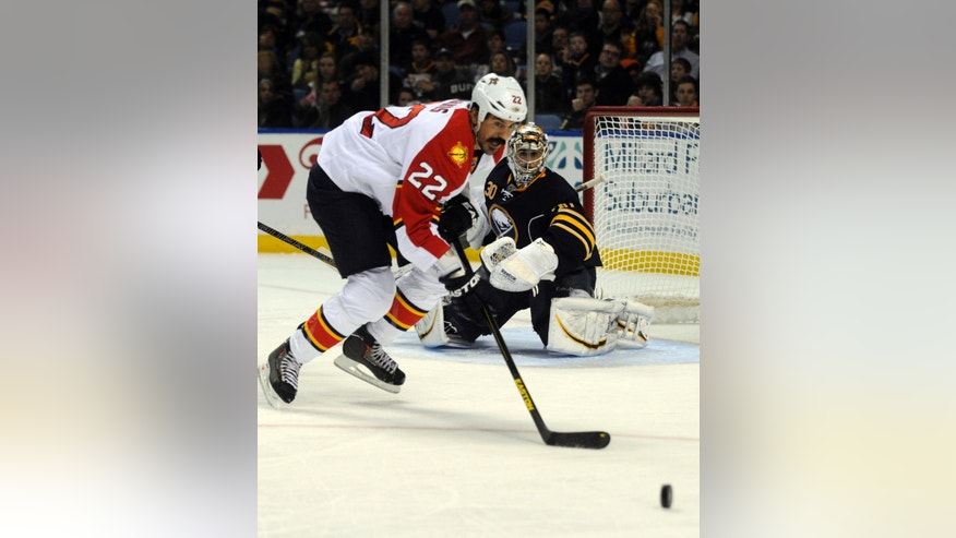 Florida Panthers right winger George Parros (22) battles for a loose puck in front of Buffalo Sabres goalie Ryan Miller (30) during the second period of an NHL hockey game in Buffalo, N.Y., Sunday, Feb. 3, 2013. (AP Photo/Gary Wiepert)