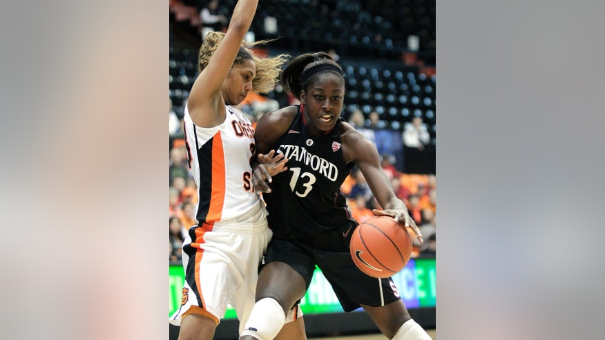 Stanford forward Chiney Ogwumike, right, drives against Oregon State guard Jasmine Camp during the first half of an NCAA college basketball game in Corvallis, Ore., Sunday, Feb. 3, 2013. (AP Photo/Don Ryan)