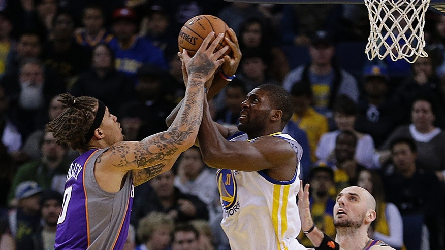 Phoenix Suns' Michael Beasley, left, and Golden State Warriors' Festus Ezeli fight for the ball in the first half of an NBA basketball game Saturday, Feb. 2, 2013, in Oakland, Calif. (AP Photo/Ben Margot)
