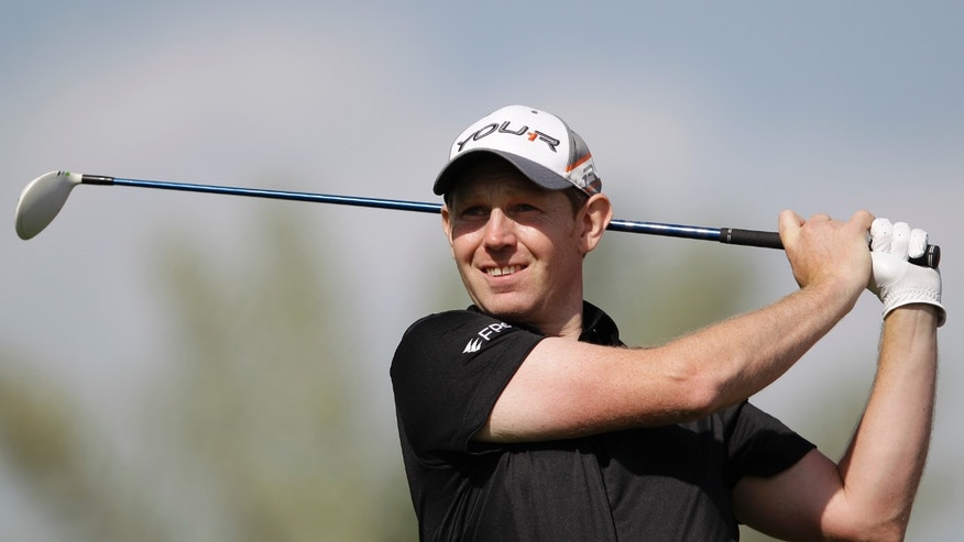 Stephen Gallacher of Scotland tees off on the 9th hole during final round of the Dubai Desert Classic Golf tournament in Dubai, United Arab Emirates, Sunday, Feb. 3, 2013. (AP Photo/Kamran Jebreili)
