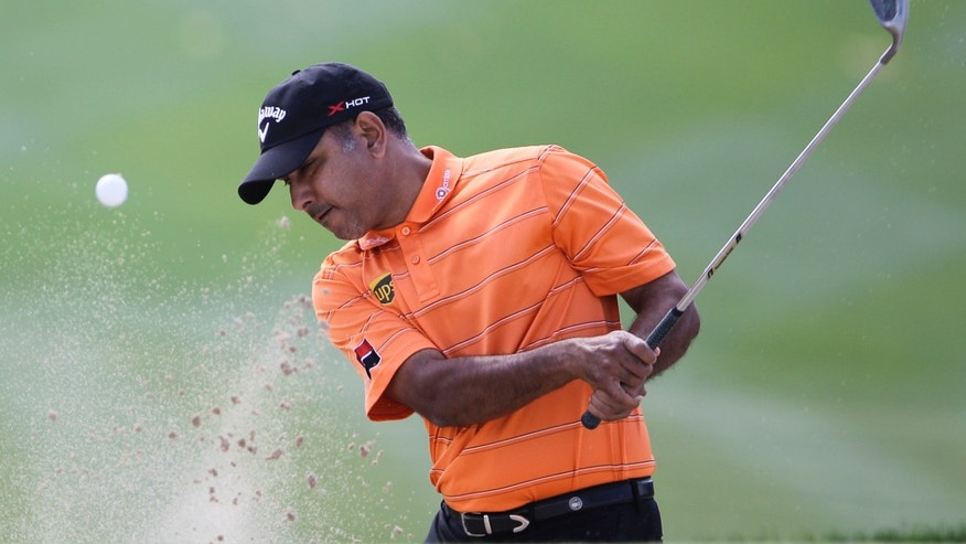 India's Jeev Mikha Singh plays a ball on the 1st hole during final round of the Dubai Desert Classic Golf tournament in Dubai, United Arab Emirates, Sunday, Feb. 3, 2013. (AP Photo/Kamran Jebreili)