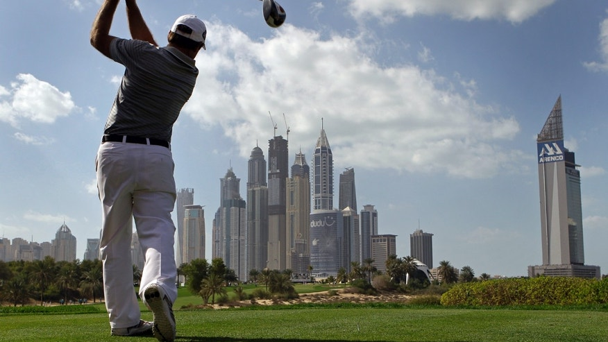 Richard Sterne from South Africa tees off on the 8th hole during final round of the Dubai Desert Classic Golf tournament in Dubai, United Arab Emirates, Sunday, Feb. 3, 2013. (AP Photo/Kamran Jebreili)
