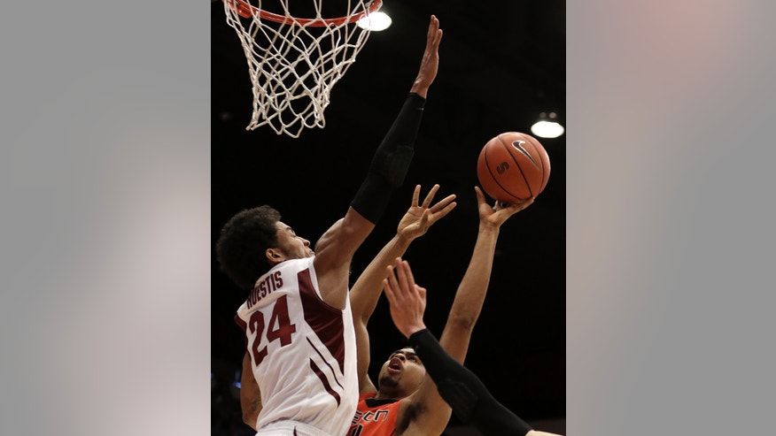 Stanford's Josh Huestis, left, blocks the shot of Oregon State's Devon Collier in the final seconds of an NCAA college basketball game on Sunday, Feb. 3, 2013, in Stanford, Calif. (AP Photo/Ben Margot)