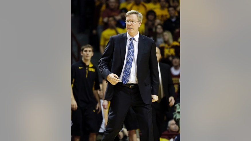 Iowa head coach Fran McCaffery watches the final minutes of an NCAA college basketball game against Minnesota, Sunday, Feb. 3, 2013, in Minneapolis. Minnesota won 62-59. (AP Photo/Jim Mone)