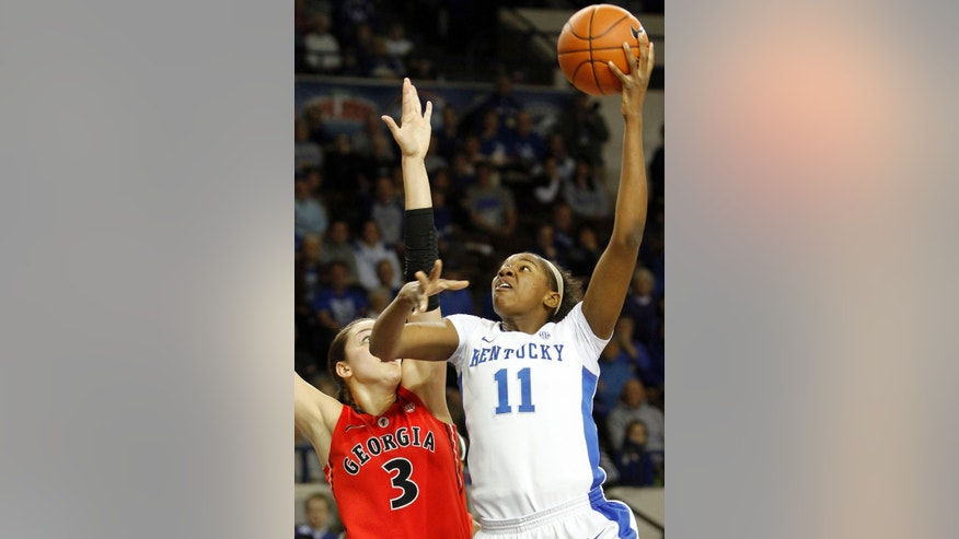 Kentucky's DeNesha Stallworth (11) shoots under pressure from Georgia's Anne Marie Armstrong during the first half of an NCAA college basketball game at Memorial Coliseum in Lexington, Ky., Sunday, Feb. 3, 2013. (AP Photo/James Crisp)