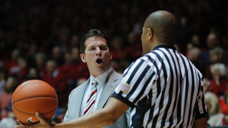 New Mexico head coach Steve Alford, left, questions a foul that was not called in the first half during an NCAA college basketball game against Nevada, Saturday, Feb. 2, 2013, in Albuquerque, N.M. (AP Photo/Jake Schoellkopf)