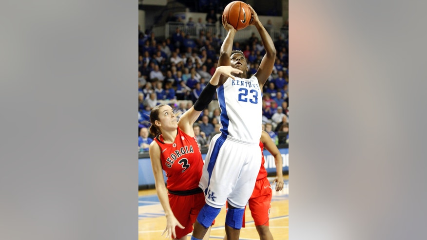 Kentucky's Samarie Walker (23) shoots under pressure from Georgia's Anne Marie Armstrong (3) during the first half of an NCAA college basketball game at Memorial Coliseum in Lexington, Ky., Sunday, Feb. 3, 2013. (AP Photo/James Crisp)