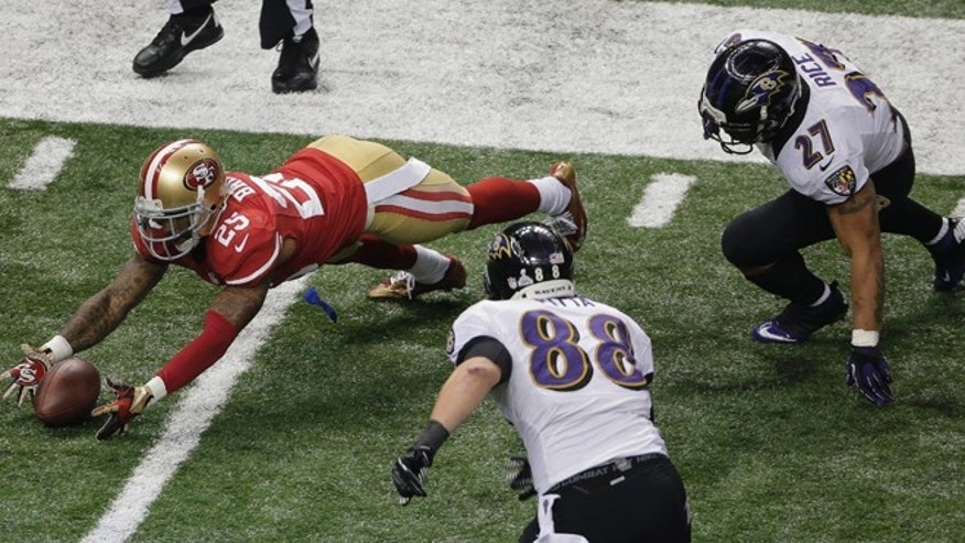 Feb. 3, 2013: San Francisco 49ers cornerback Tarell Brown (25) recovers a fumble by Baltimore Ravens running back Ray Rice (27) as tight end Dennis Pitta (88) closes in during the second half of the NFL Super Bowl XLVII football game, Sunday in New Orleans.