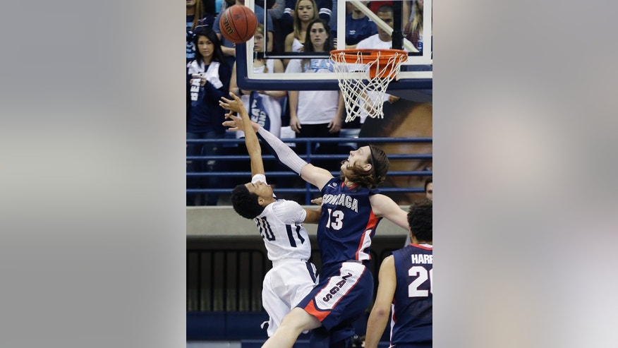 Gonzaga forward Kelly Olynyk blocks the shot of San Diego's Christopher Anderson during the first half of an NCAA college basketball game Saturday Feb. 2, 2013 in San Diego. (AP Photo/Lenny Ignelzi)