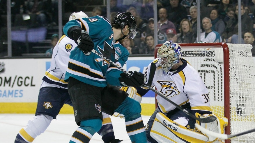 Nashville Predators goalie Pekka Rinne (35), of Finland, blocks a shot on goal by San Jose Sharks left wing Martin Havlat (9), of the Czech Republic, during the first period of an NHL hockey game in San Jose, Calif., on Saturday, Feb. 2, 2013. (AP Photo/Tony Avelar)