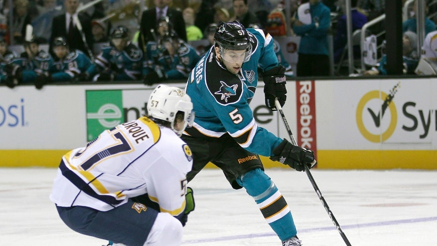 San Jose Sharks Jason Demers (5) skates past Nashville Predators left wing Gabriel Bourque (57) during the first period of an NHL hockey game in San Jose, Calif., on Saturday, Feb. 2, 2013. (AP Photo/Tony Avelar)