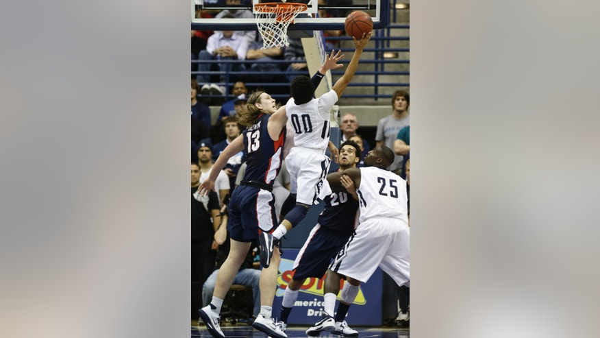 San Diego guard Christopher Anderson (00) shoots and scores over Gonzaga forward Kelly Olynyk during the second half of an NCAA college basketball game on Saturday Feb. 2, 2013 in San Diego. Gonzaga won 65-63. (AP Photo/Lenny Ignelzi)