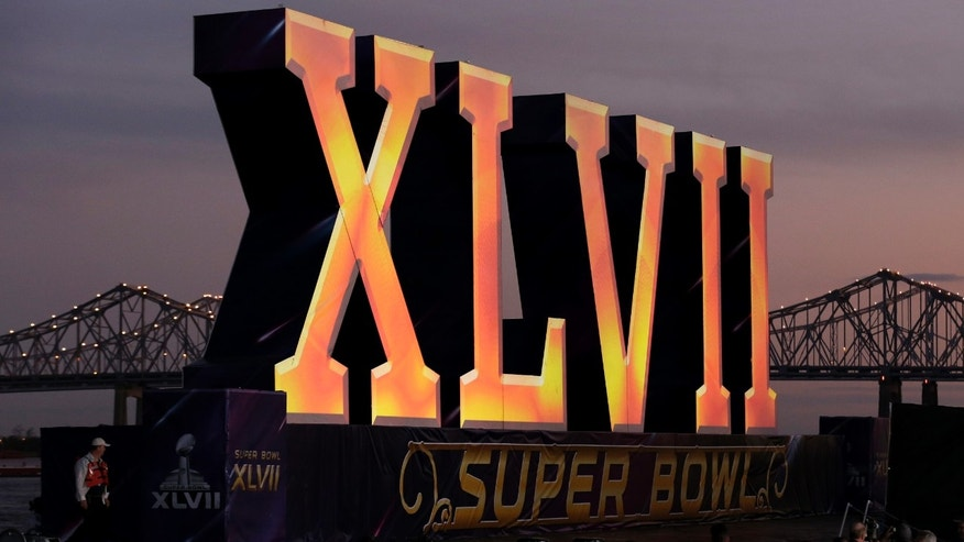 The Roman numerals for NFL Super Bowl XLVII float on the Mississippi River Saturday, Feb. 2, 2013, in New Orleans. (AP Photo/Charlie Riedel)