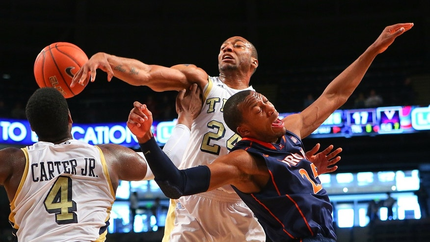 020313 ATLANTA: Georgia Tech forward Kammeon Holsey, center, and Virginia forward Akil Mitchell battle for a rebound during the first half of their NCAA college basketball game Sunday Feb. 3, 2013, in Atlanta.    (AP Photo/Atlanta Journal-Constitution, Curtis Compton)  MARIETTA DAILY OUT; GWINNETT DAILY POST OUT; LOCAL TV OUT; WXIA-TV OUT; WGCL-TV OUT  MBI  (REV-SHARE)