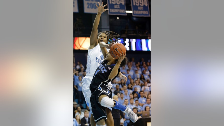 Duke's Chloe Wells (4) drives to the basket as North Carolina's Tierra Ruffin-Pratt defends during the first half of an NCAA college basketball game in Chapel Hill, N.C., Sunday, Feb. 3, 2013. (AP Photo/Gerry Broome)
