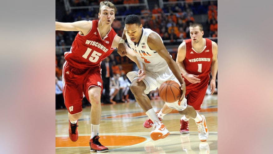 Illinois' guard Joseph Bertrand (2) tries to drive past Wisconsin's forward Sam Dekker (15) after getting by Wisconsin's guard Ben Brust (1)in the first half of an NCAA college basketball game at Assembly Hall in Champaign, Ill., Sunday, Feb. 3, 2013. (AP Photo/Robin Scholz)
