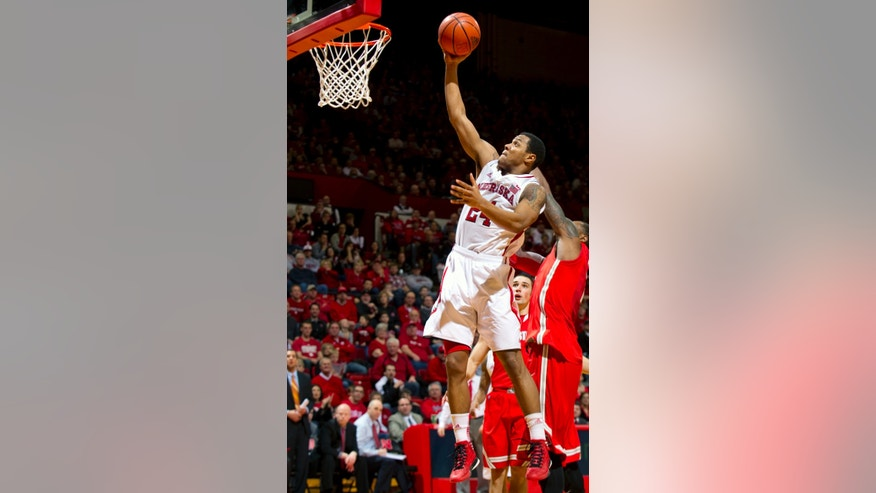 Nebraska's Dylan Talley (24) shoots against Ohio State's Deshaun Thomas (1) during the second half  of an NCAA college basketball game on Saturday, Feb. 2, 2013, at the Bob Devaney Sports Center, in Lincoln, Neb. (AP Photo/The Journal-Star, Matt Ryerson)