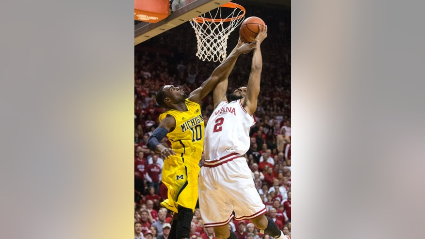 Indiana's Christian Watford (2) drives to the basket and is fouled by Michigan's Tim Hardaway Jr. (10) during the second half of an NCAA college basketball game Saturday, Feb. 2, 2013, in Bloomington, Ind. Indiana defeated Michigan 81-73. (AP Photo/Doug McSchooler)